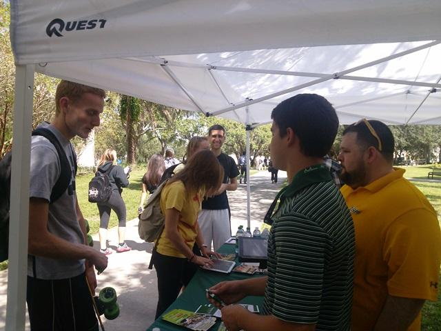 Students and USF Student Government representatives talk outside the College of Education on the Tampa campus Tuesday.