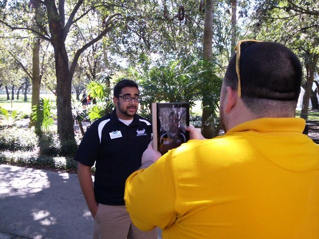 USF Student Govt. Senator Adeel Hassan (left) speaks to legislators as fellow Senator Christopher Cano records it.