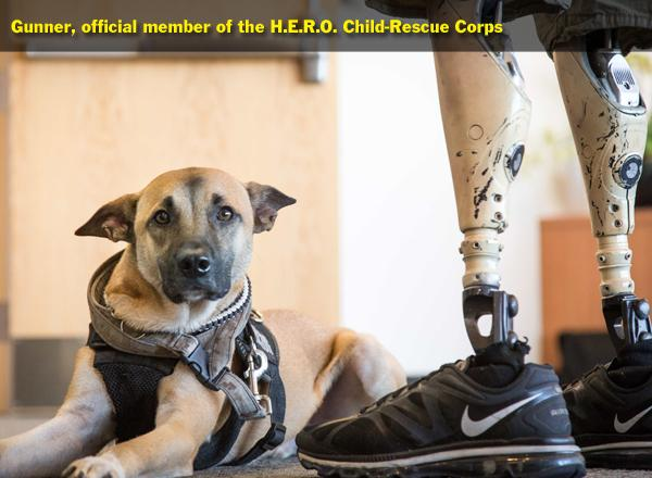 Gunner, Justin Gaertner's service dog, has become the mascot of the first class of the HERO Corps.