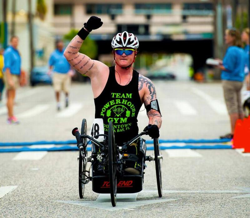 Justin Gaertner finishing first in the 10K hand-cycling event at the 2013 National Veterans Wheelchair Games in Tampa.