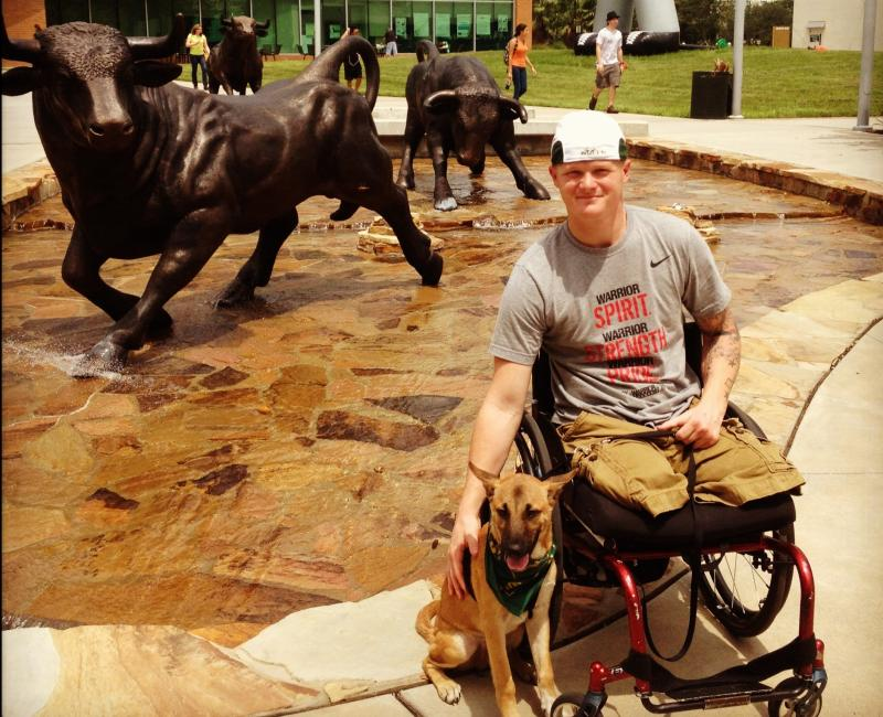 Justin Gaertner with his service dog Gunner at the University of South Florida where he attended college.
