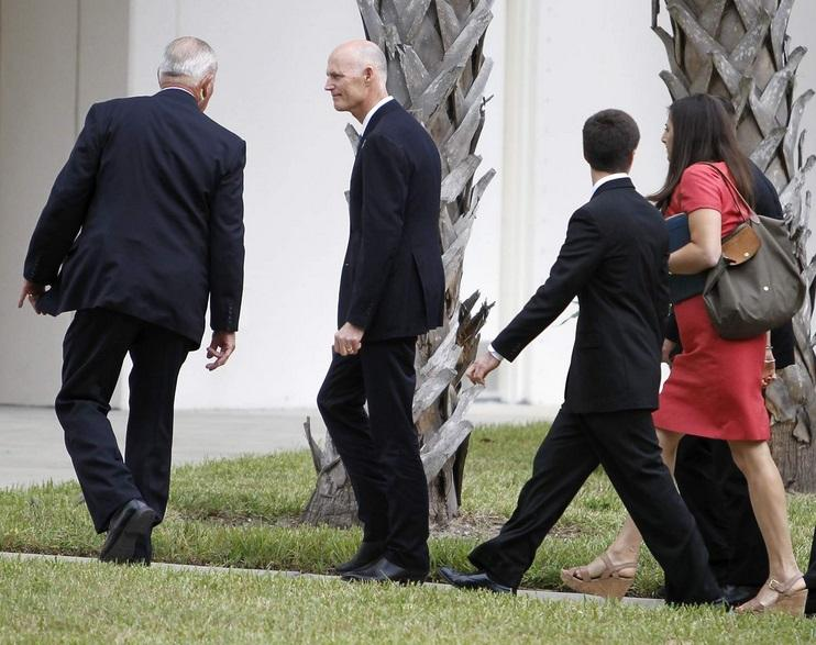 Gov. Rick Scott on his way to the funeral