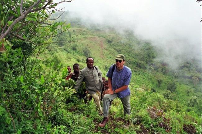 John Arthur (front) explores the Ochollo Borada site, the original historical settlement of the Borada Gamo people in Ethiopia