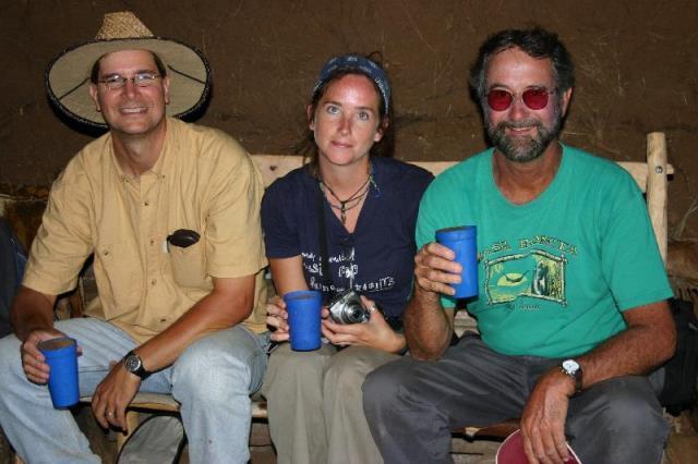 John Arthur (l) enjoys an Ethiopian beer with colleagues