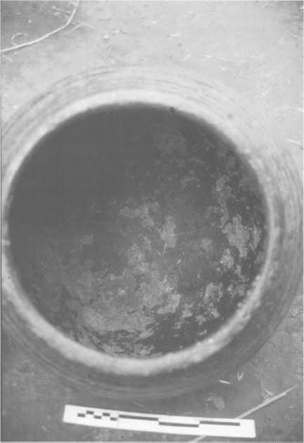 Large jar showing severe interior surface attrition caused by the Gamostoring beer.