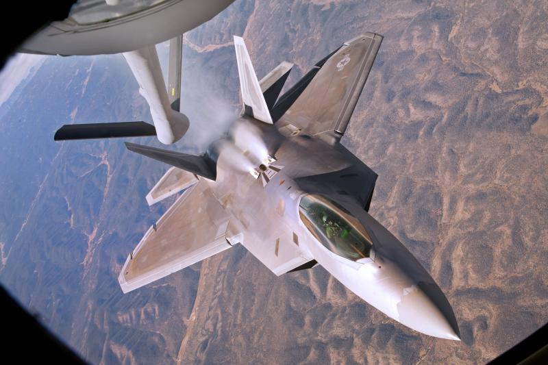 A U.S. Air Force F-22 Raptor backs away from a KC-135 Stratotanker aircraft during a refueling mission over New Mexico, Oct. 23, 2013.