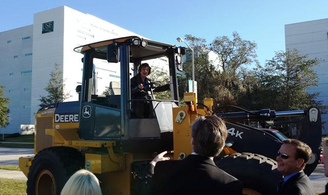USF President Judy Genshaft checks out some of the construction equipment
