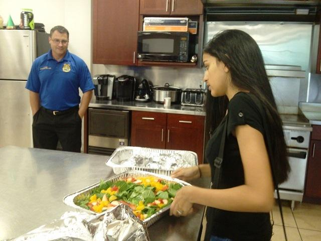 Vaneesha Patel gets lunch ready for Temple Terrace firefighters while Asst. Fire Chief Ian Kemp watches