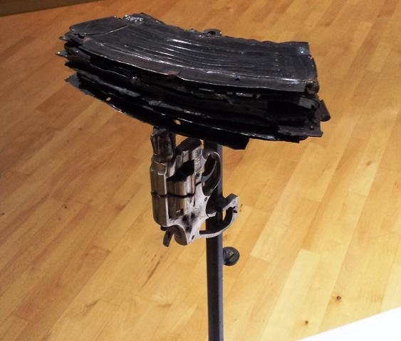 'cowbell' made out of empty gun clips