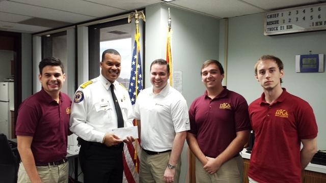 TFR Chief Forward poses with Romero (left) and fellow members of the USF Chapter of Pi Kappa Alpha