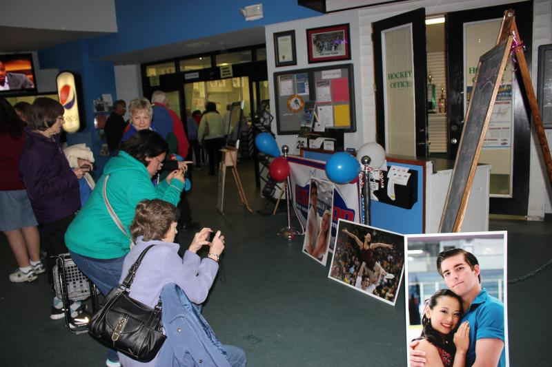 Fans of Olympic figure skaters Felicia Zhang and her partner, Nathan Bartholomay, snap photos of memoribilia at the Ellenton Ice and Sports Complex.