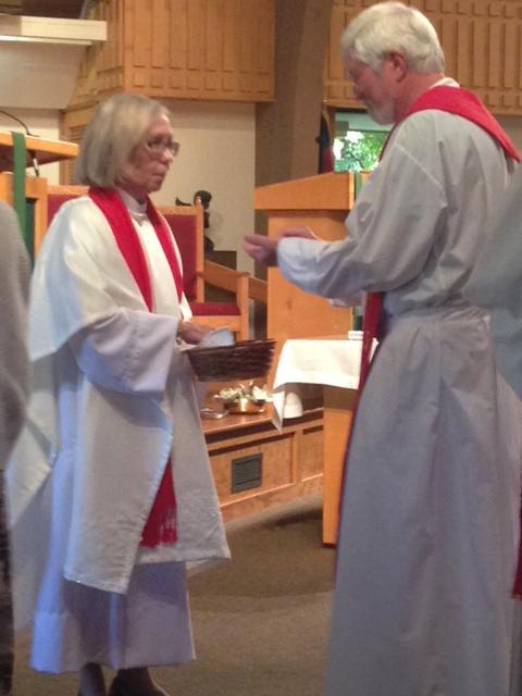 Maureen McGill participates in the communion.