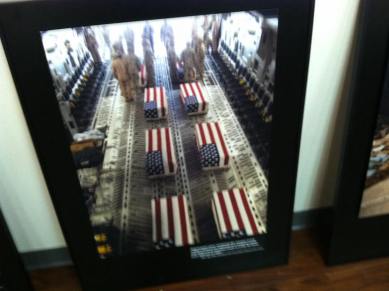For a time, the White House blocked the public release of photos of the fallen returning home and that's why curator Cyma Rubin included it in her exhibition.