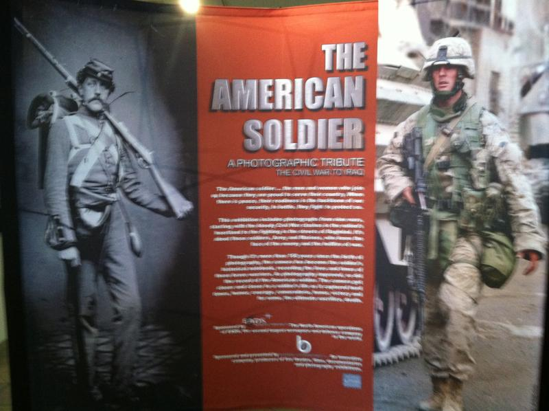 The opening panel for the exhibit shows how uniforms and weapons have changed, but not the face of the American soldier.