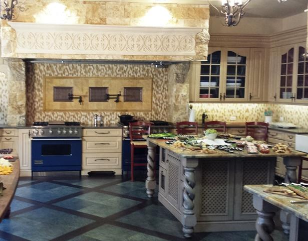 The Tuscan-style kitchen boasts two high-end stoves and a subzero freezer.