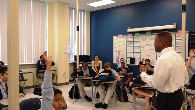Dr. Kevin Sneed, Dean of the USF College of Pharmacy, talks to students at Franklin Middle Magnet School's Career Day.