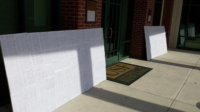 Two of the signs containing some of the 10,000 student signatures on the petition.