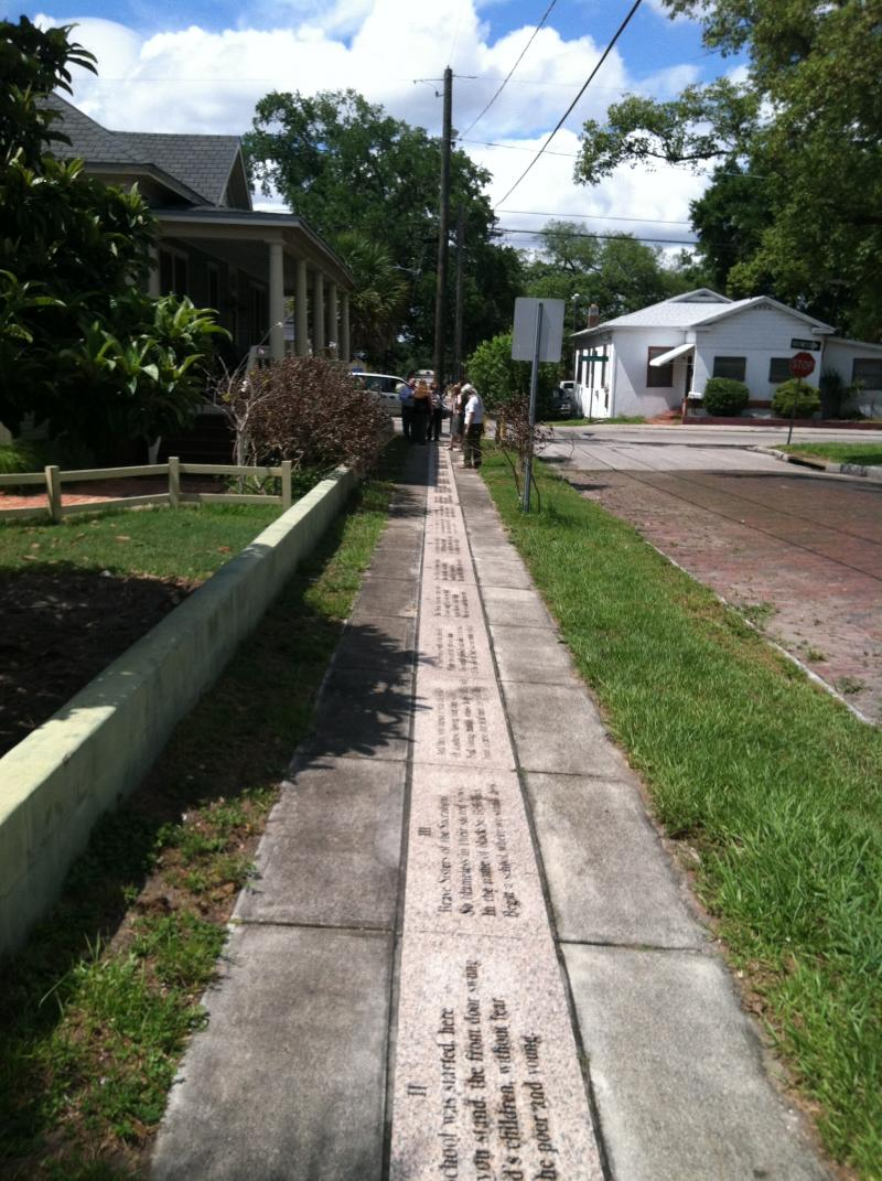 A poem embedded in the sidewalk outside a neighborhood of restored casitas along Columbus Drive, just north of I-4