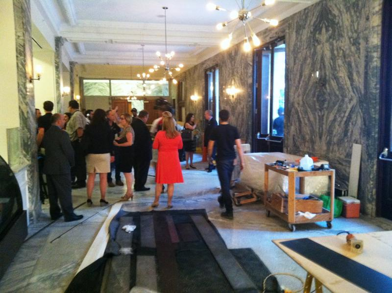 Workers finish the renovation during a gathering in the main restauant