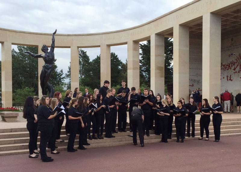 The East Lake High School Choir preparing to perform at the American Cemetery overlooking Omaha Beach in France.