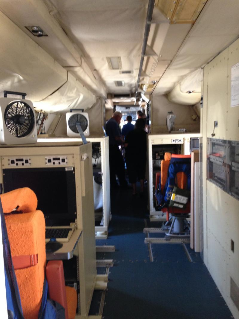Narrow walkways and workstations fill much of the NOAA P-3 turboprop aircraft.