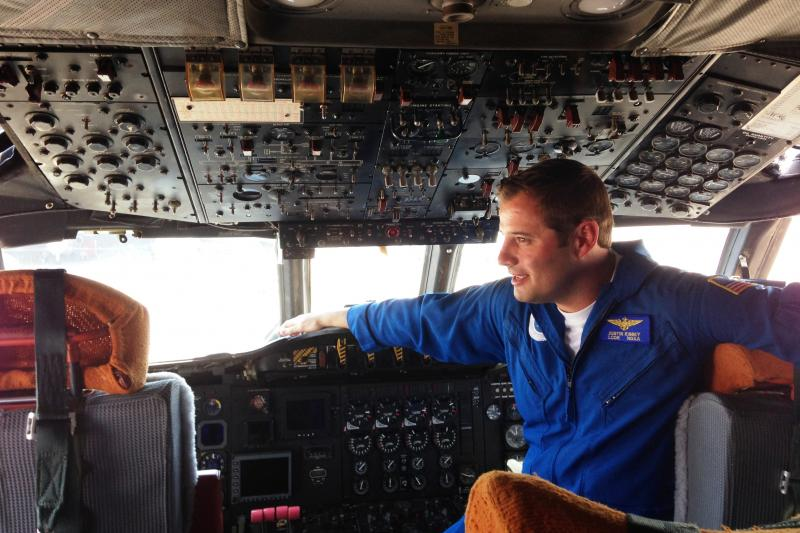 Lieutenant Commander Justin Kibbey pilots one of the two P-3 turboprop aircraft  used for hurricane hunting.