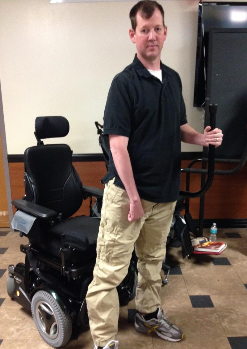 Veteran Ty Edwards can stand up from his motorized wheelchair without someone's help when he uses the stand bar.