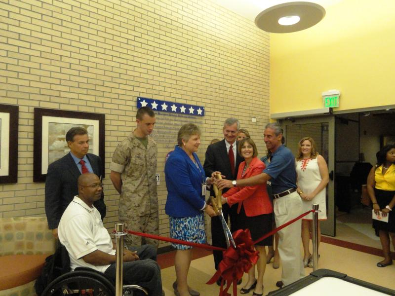 U.S. Rep. Kathy Castor and Hospital Director Kathleen R. Fogarty performed the ribbon-cutting, alongside the Managing Director of the Armed Forces Families Foundation (Nick Peters) and USO Senior Vice President (John Hanson).