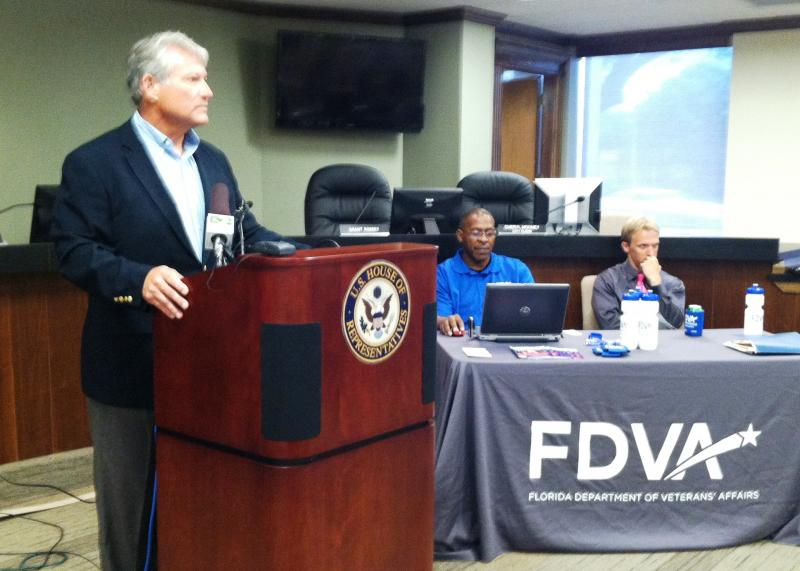 Representatives from the Florida Department of Veterans' Affairs seated at the table were there to help at the veterans intake arranged by U.S. Rep. Dennis Ross (left).