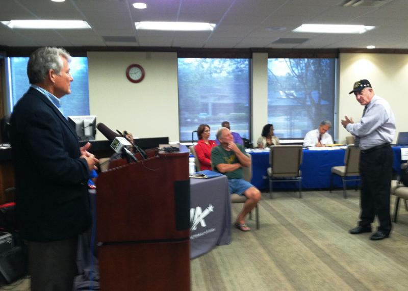 During a news conference, U.S. Rep. Dennis Ross (left)takes a question from veteran Luis Canino Mas (standing).