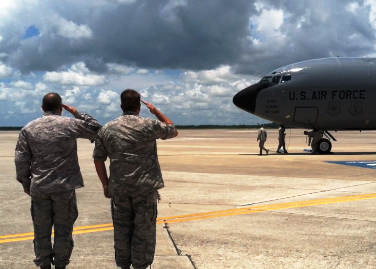 Col. Scott DeThomas is saluted as his KC-135 Stratotanker comes to a stop on the MacDill AFB tarmac.