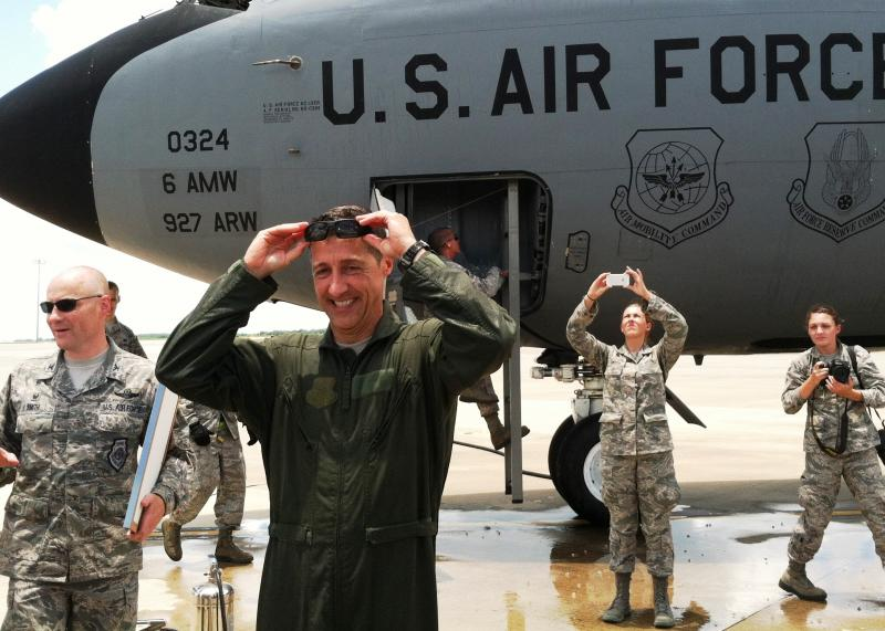 Col. Scott DeThomas is all laughs after taking his drenching. He logged more than 3,000 flight hours in nine different aircraft before retiring.