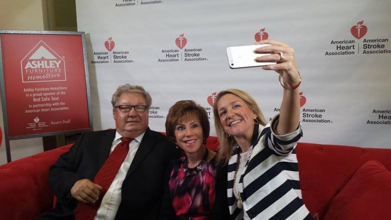 USF President Judy Genshaft (center) takes a selfie with Ashley Furniture Founder Ron Wanek (left), and Lily Reisman of the American Heart Association