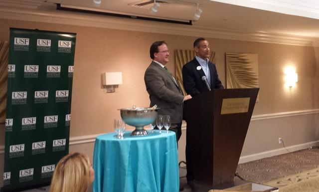 USFSM College of Hospitality and Technology Leadership Dr. Cihan Cobanoglu (left) and Jeffery Mayers speak at the announcement of the partnership between the two groups.