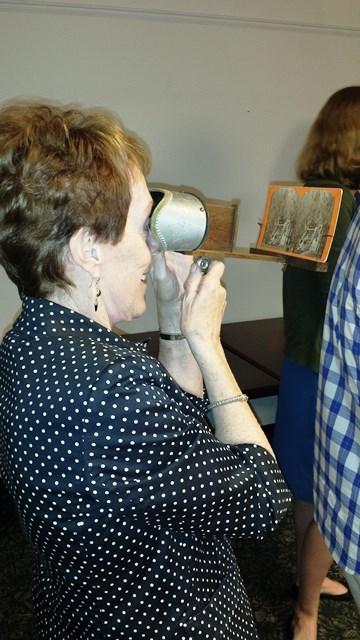 Former USF President Betty Castor checks out a stereoscope.