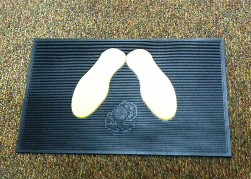 The floormat outside Tedd Weiser's door replicates the yellow footprints outside the Marine Corps recruit depots.