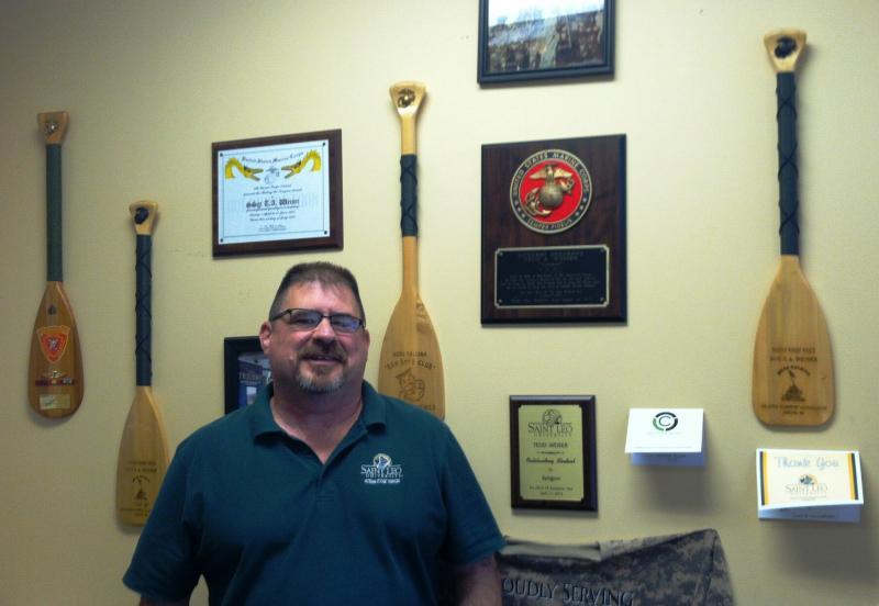 "Tedd ""Gunny""Weiser has an impressive display of Marine Corps memorabilia on his office wall."