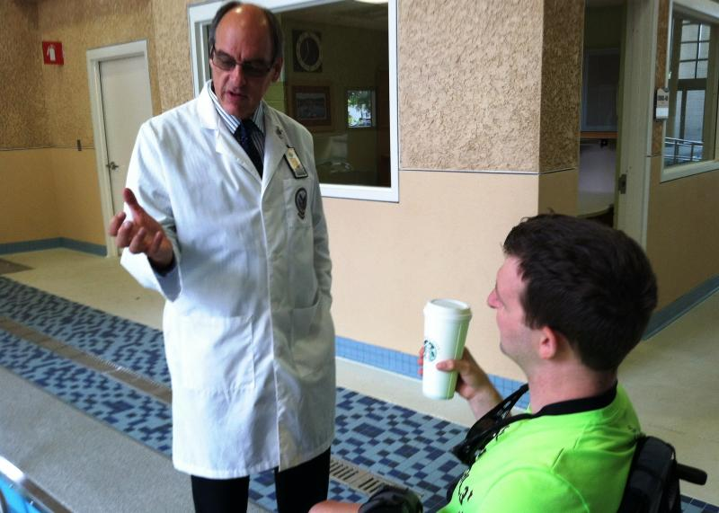 Dr. Steven Scott, director of the Polytrauma Center at James A. Haley VA Hospital, talks with his former patient, Army Ranger Cory Remsburg.