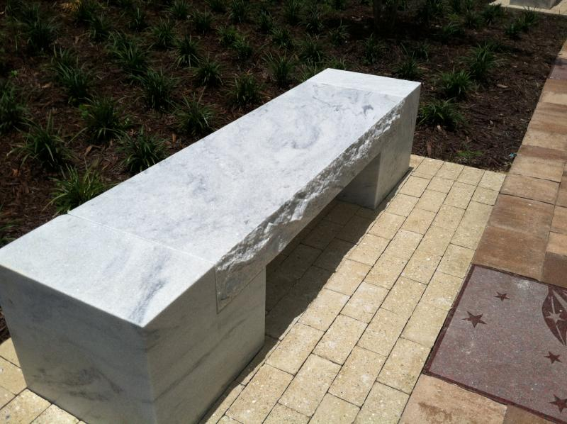 Marble benches dot the plaza offering visitors a place to sit and soak-in their surroundings.
