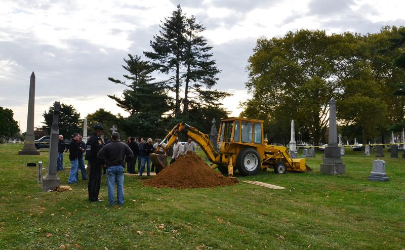 Bulldozers exhume the casket
