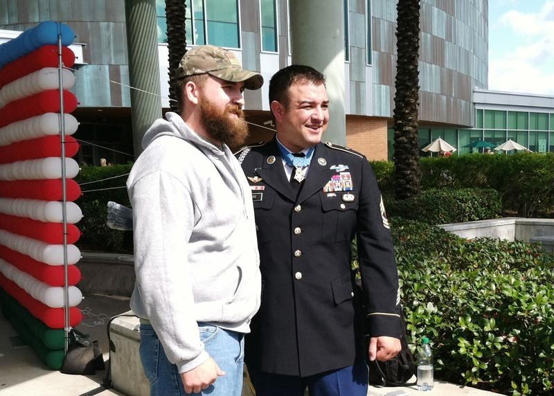 Army MSgt. Leroy Petry (right) poses for a photo with an unidentified veteran after his speech at USF in Tampa.