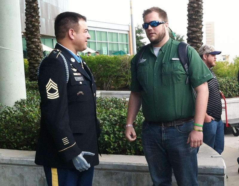 Army MSgt. Leroy Petry chatting with one of the 200 who came out to meet him Tuesday at USF Tampa campus.