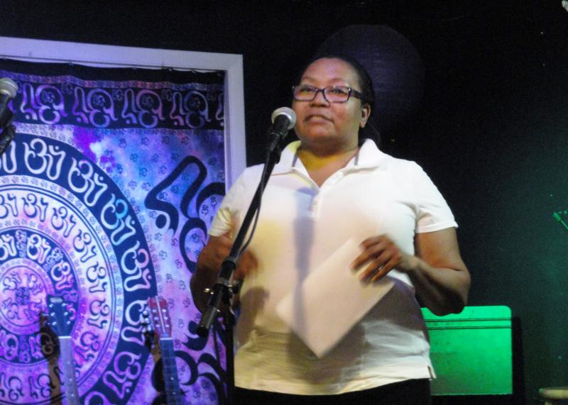 Veteran, poet and preacher Charla Gautierre performs at Open Mic Night.