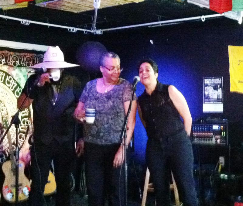 Veteran Frank (Left), Playwright Linda Parris-Bailey (center) and Andrea Assaf, director of Art2Action, on stage at the Veterans Open Mic Night.