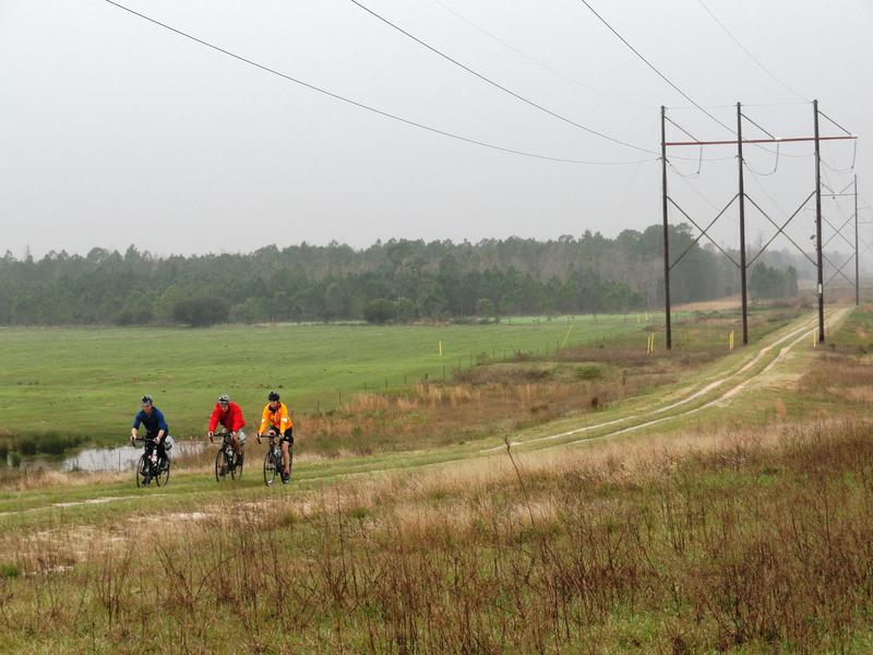 Expedition members bike across the Hilochee preserve in Polk County