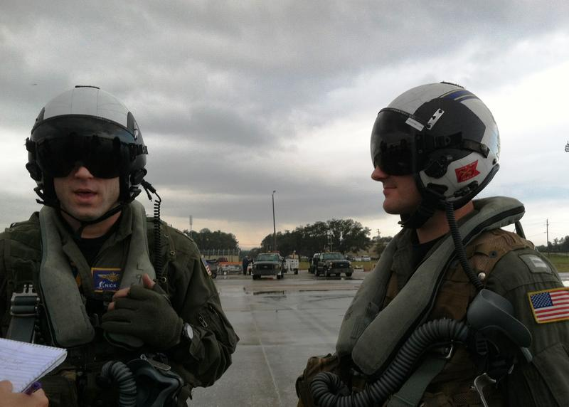 Navy Lts. Nick Adams (left) and Kevin Loughmiller after returning from a laser weapons training flight.