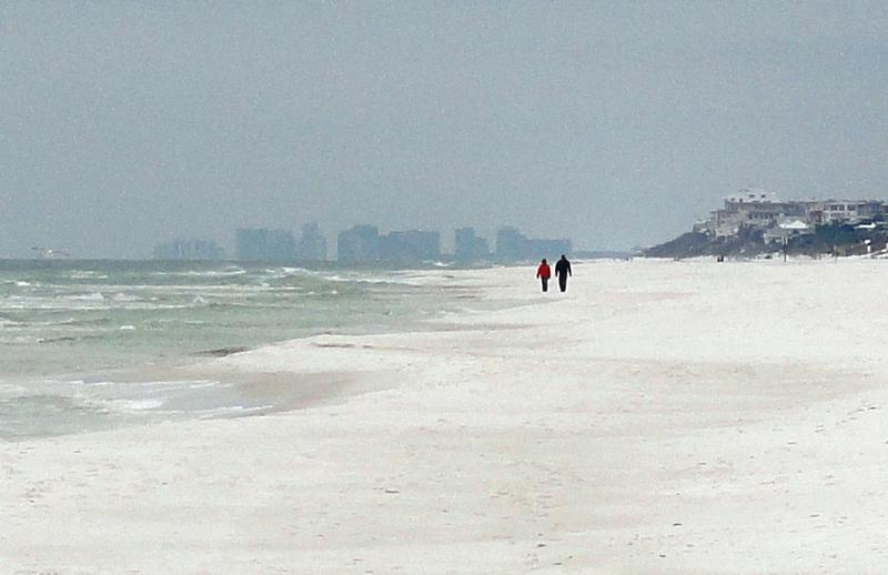Beachside towers of Destin loom in the distance