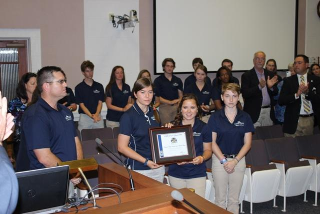 Students from Eckerd College EC-SAR Team receive a plaque from the St. Petersburg City Council honoring them for recovering Phoebe Johnchuck from the Bay this past January.