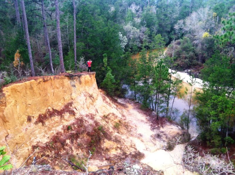 Expedition photographer Carlton Ward Jr. shoots the massive bluffs overlooking Juniper Creek
