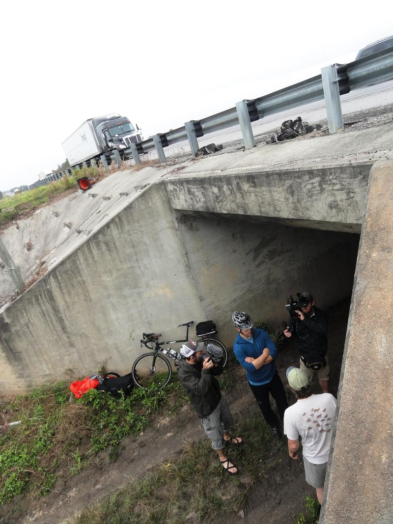 Documentary filmmakers capture the Florida Wildlife Corridor Expedition as they pass through a cattle crossing under Interstate 4 in Polk County